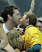 Matthew Mitcham celebrates his Gold Medal victory in Beijing with partner Lachlan Fletcher